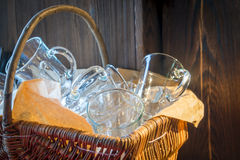 Clean   glasses in a wicker basket Royalty Free Stock Photography