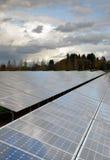 Clean Green Energy Farm Solar Power Panels. The sun hits panels on a green solar energy farm Stock Photos