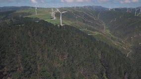 Aerial Revealing Shot Wind Turbine Generators 4k. Clean green energy generations, 4k aerial footage on cliff lines stock video footage
