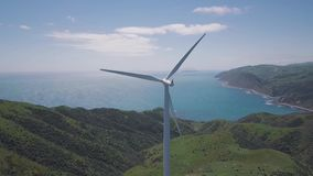 Aerial Rotating Wind Turbine Generators 4k. Clean green energy generations, 4k aerial footage on cliff lines stock footage