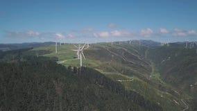 4K Aerial Establishing Shot, Wind Farm. Clean green energy generations, 4k aerial footage on cliff lines stock video footage
