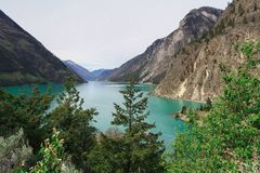 Lillooet lake on the foot of mountain. The clean green water of lillooet lake on the foot of mount Royalty Free Stock Photos
