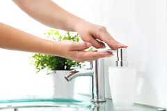Clean hands, wash your hands in the bathroom. Woman wash her hands under water royalty free stock images