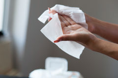 Clean hands with wet wipes. Young woman clean hands with wet wipes stock images