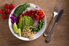 Clean healthy detox eating. Vegan and vegetarian lunch bowl. Quinoa, avocado, pomegranate, tomatoes, green peas, radish and red ca. Bbage salad. View from above stock photos