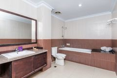 Clean and Huge hotel bathroom. Huge bathroom photos at cheap prices hotel in Bali. Photographed during day time. Walls and floors are made of marble. Inside is a royalty free stock photography
