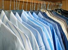 Clean Hung shirts wardrobe Stock Images