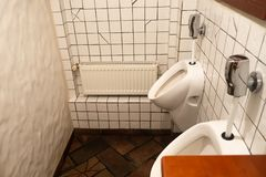 Clean and hygiene bathroom with white male toilet bowl in male toilet room, wc stock photography