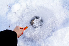 Clean ice hole in frozen lake for winter fishing Royalty Free Stock Images