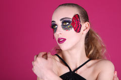 Clean Image of A woman With Butterfly Make Up Stock Image