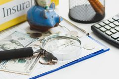 Clean insurance blank, American dollars, magnifying glass, calculator and piggy bank. Soft focus background Stock Images