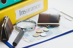 Clean insurance blank, Polish zloty, magnifying glass and wallets Royalty Free Stock Photography