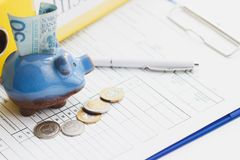 Clean insurance blank, Polish zloty, piggy bank and a pen Royalty Free Stock Images