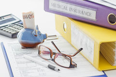 Clean insurance form, folders, pen, piggy bank and calculator. Soft focus background Royalty Free Stock Image