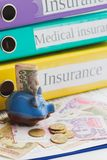 Clean insurance form, piggy bank and money Royalty Free Stock Photography