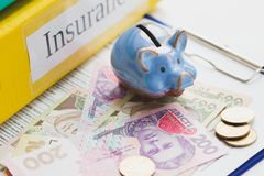 Clean insurance form, piggy bank and money Stock Photography