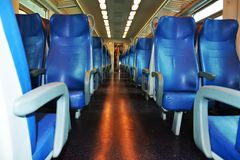 Clean Italian train, Venice, close up. Chairs, beautiful windows, in a speedy Italian train, in Venice, Italy, Europe. Lights on, in the evening Stock Images