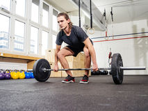Clean and jerk at the gym. Photo of a handsome young man lifting a heavy barbell for a clean and jerk movement at the gym Stock Photos