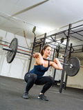 Clean and jerk at the gym Royalty Free Stock Photos