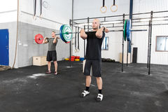 Clean and jerk workout at fitness gym center Stock Image