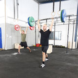 Clean and jerk workout at fitness gym center Royalty Free Stock Photography
