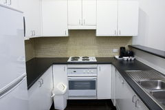 Clean kitchen area in hotel room Royalty Free Stock Image
