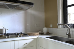 Clean the kitchen. Practical sink, stove and chopping block royalty free stock photography