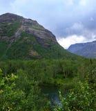 Clean lake at the foot of the Khibiny mountains, Kola Peninsula,. Russia Stock Images