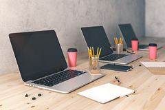 Clean laptop displays on desk side Stock Photo