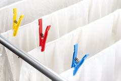 Clean laundry and clothespins Stock Photos