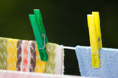 Clean laundry with clothespins on clothesline Royalty Free Stock Photography