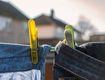 Clothes drying on a washing line. Clean laundry drying on a washing line in a residential garden royalty free stock photos