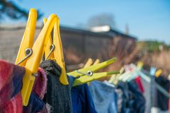 Clothes drying on a washing line. Clean laundry drying on a washing line in a residential garden royalty free stock images