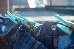 Clothes drying on a washing line. Clean laundry drying on a washing line in a residential garden royalty free stock photography