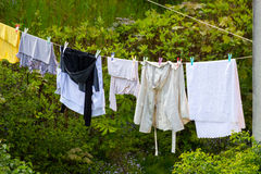 Clean laundry hanging to dry on line outdoor Stock Images