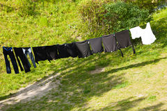 Clean laundry hanging to dry on line outdoor Stock Image