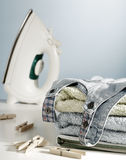 Clean laundry and iron Royalty Free Stock Photos