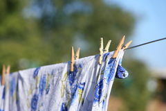 Clean linen hungs on rope dries Stock Photo