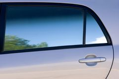 Clean lines and shades of a car door and window Royalty Free Stock Images