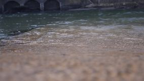 Clean looking river water moving passed stock video footage