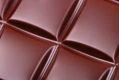 clean mörkt foto för stångchoklad Arkivbilder