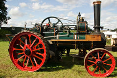 Clean machine. A brightly coloured steam driven traction engine at a country fair stock images