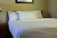 Clean made bed Stock Photo