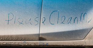 Clean me written on car. Clean me written on a dirty car stock photography