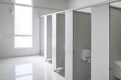 Clean men public toilet room empty, interior design. Clean men public toilet room empty with big window and light from outside, interior Royalty Free Stock Photography
