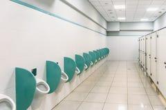 Clean men public toilet room interior. Perspective Stock Photo