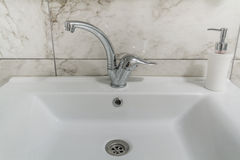 Clean modern bathroom chrome faucet Stock Images