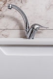 Clean modern bathroom chrome faucet Royalty Free Stock Image