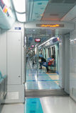 Clean and modern metro train, part of Dubai's advanced, high-tec. DUBAI, UAE - 16 JULY 2014: Commuters riding to work on a clean and modern metro train, part of stock photo