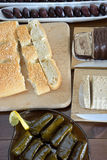 Clean Monday fasting food. Olives, halva, lagana, stuffed grape leaves are some fasting food for Clean Monday Royalty Free Stock Photography